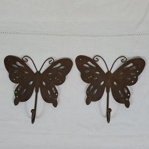 Two metal wall butterfly hooks